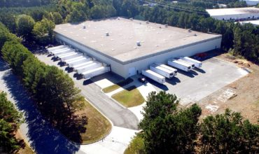 Aerial view of ABW7000 warehouse with trailers in the dock doors