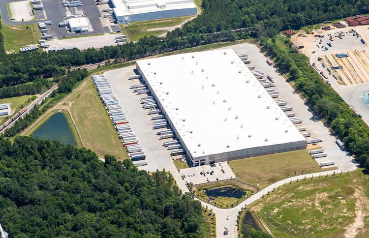 Aerial view of ABW Greenville, MS warehouse with tractor trailers at the dock doors