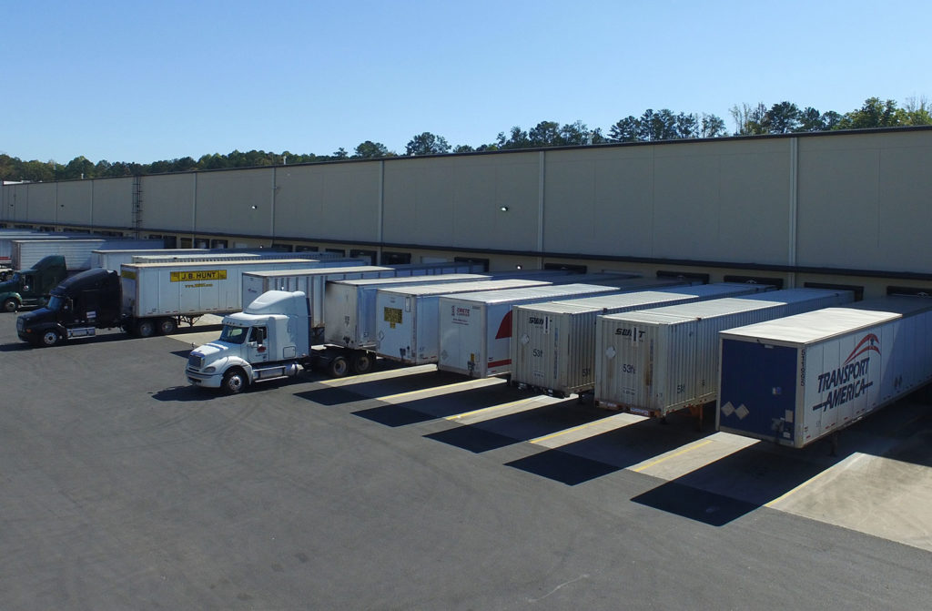 ABW114 warehouse with trailers at the dock doors
